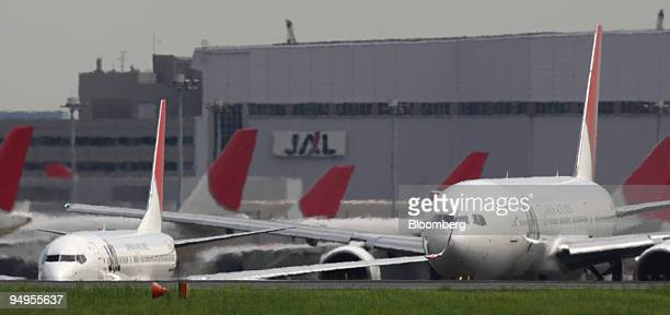 Japan Airlines Corp airplanes are parked at Haneda Airport in Tokyo Japan on Thursday Sept10 2009 American Airlines the world's secondlargest carrier...