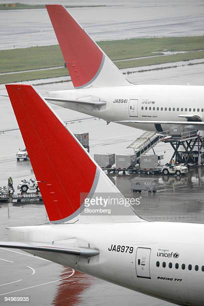 Japan Airlines Corp airplanes are parked at Haneda Airport in Tokyo Japan on Tuesday July 21 2009 American Airlines the world's secondlargest carrier...