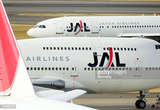 Japan Airlines Corp passenger jets are parked at Haneda airport in Tokyo Japan on Saturday Jan 19 2008 Japan Airlines International Co agreed to pay...