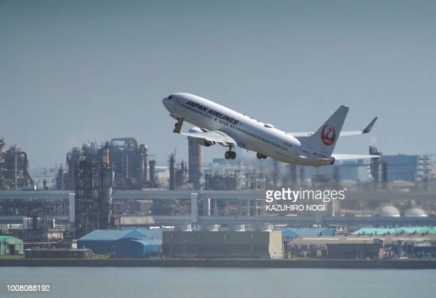 A Japan Airlines passenger jet takes off from Tokyo's Haneda airport in Tokyo on July 31 2018 Major Japanese carriers All Nippon Airways and Japan...