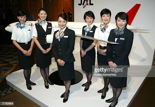 Japan Airlines Systems flight attendants wear the newly designed uniform during a photo session at a press preview on July 10 2003 in Tokyo Japan