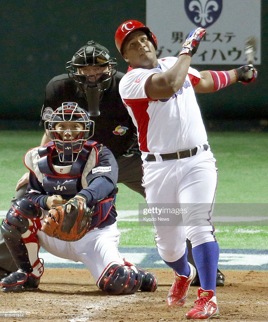 FUKUOKA, Japan - Alfredo Despaigne of Cuba hits a three-run homer in the eighth inning of a World Baseball Classic first-round game against Japan at Fukuoka Dome in Fukuoka, Japan, on March 6, 2013. The Japanese catcher is Ryoji Aikawa. Cuba won 6-3.