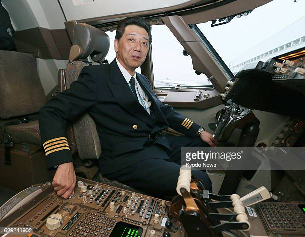 TOKYO Japan All Nippon Airways Co pilot Michihiko Tanaka sits in the cockpit of a Boeing 747 at Tokyo's Haneda airport on Dec 18 2013 The Japanese...