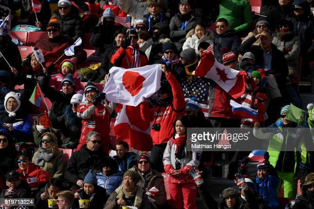 Japan and Canada fans fly the flag at the finish during the Alpine Skiing Men's Giant Slalom on day nine of the PyeongChang 2018 Winter Olympic Games...