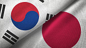 Japan and South Korea two flags together textile cloth fabric texture