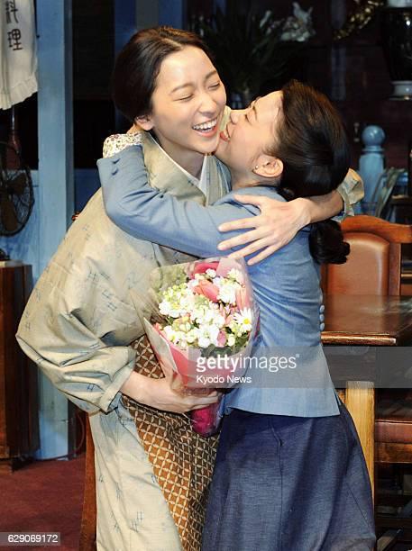 OSAKA Japan Anne Watanabe the leading actress in Japanese public broadcaster NHK's serial morning TV drama 'Gochisousan' hugs costar Mitsuki Takahata...