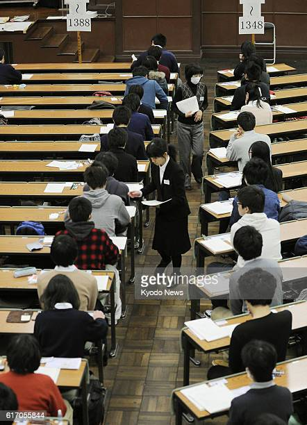 Japan - Applicants of the annual unified college entrance examinations await the start of their exams at the University of Tokyo on Jan. 14, 2012....