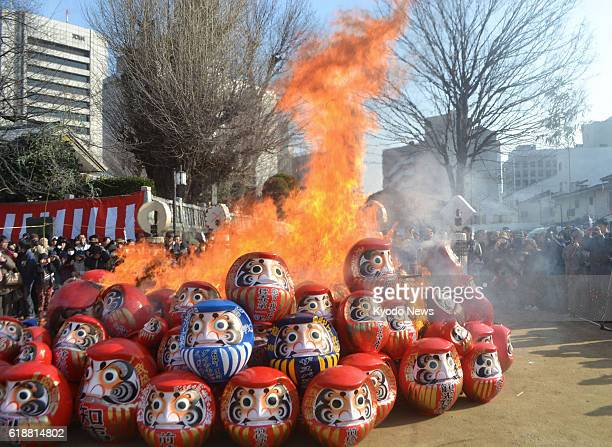 MAEBASHI Japan Around 100 Daruma dolls are burned during a rite to thank the talisman for the accomplishment of wishes at Maebashi Hachimangu shrine...