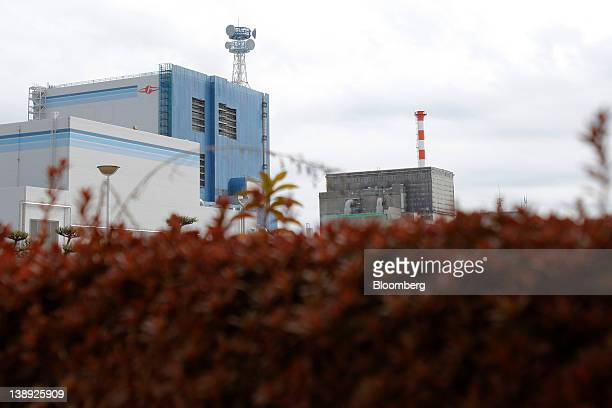 Japan Atomic Power Co.'s Tokai Dai-Ni nuclear power station, left, stands next to the decommissioned Tokai nuclear power station in Tokai Village,...