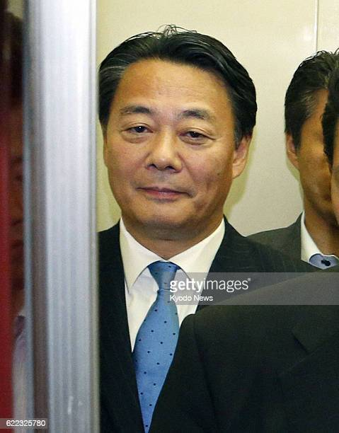 TOKYO Japan Banri Kaieda leader of the Democratic Party of Japan gets into an elevator to leave the party headquarters in Tokyo on July 22 the day...