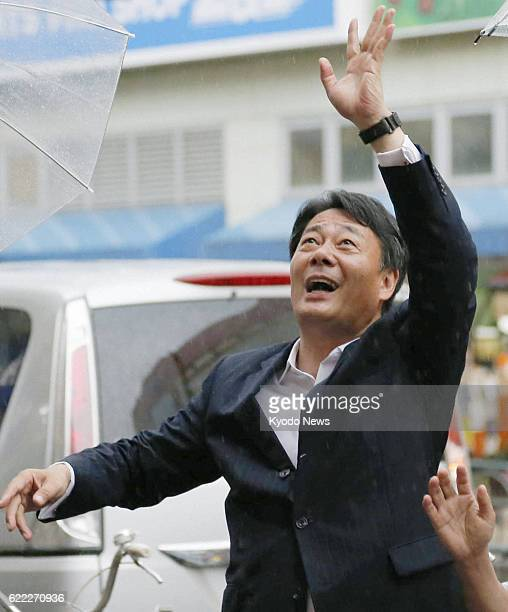 SAITAMA Japan Banri Kaieda leader of the main opposition Democratic Party of Japan waves to voters in Ageo Saitama Prefecture on July 17 ahead of the...