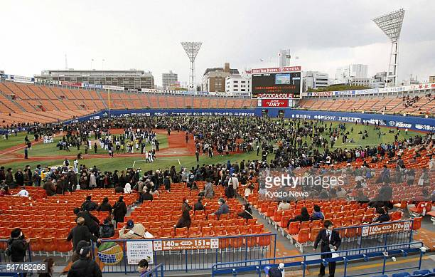 YOKOHAMA Japan Baseball fans at Yokohama Stadium in Kanagawa Prefecture evacuate to the field on March 11 after a powerful earthquake hit...