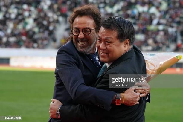 Japan Beach Soccer head coach Ruy Ramos and JFA president Kozo Tashima hug during the 99th Emperor's Cup final between Vissel Kobe and Kashima...