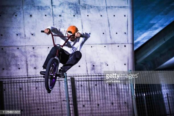 japan bmx riders jump - bmx cycling stock pictures, royalty-free photos & images