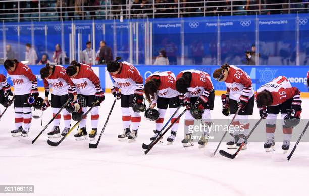 Japan bow after their game against Switzerland during the Women's Ice Hockey Classification game on day eleven of the PyeongChang 2018 Winter Olympic...