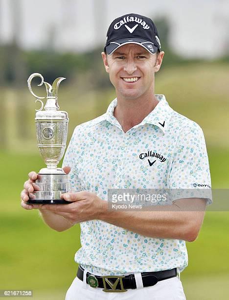 KASAOKA Japan Brendan Jones of Australia holds the victor's trophy after winning the Mizuno Open at the JFE Setonaikai Golf Club in Okayama...