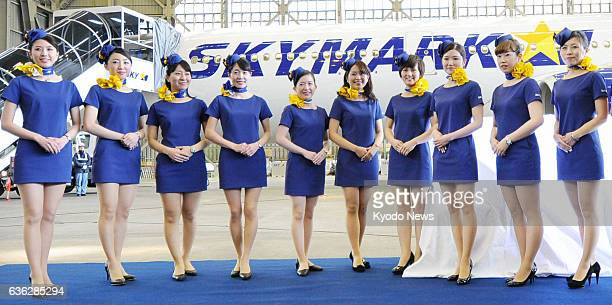 TOKYO Japan Cabin attendants of Skymark Airlines Inc's Airbus A330 aircraft clad in miniskirt uniforms pose for photos at Tokyo's Haneda airport on...