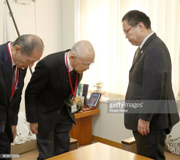 Japan Canoe Federation President Shoken Narita bows in apology to Yuzuru Imasato Sports Agency deputy director over a drinkspiking scandal involving...