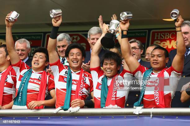 Japan captain Katsuyuki Sakai and team mates celebrate after winning the Qualifier final between Italy and Japan during the 2014 Hong Kong Sevens at...
