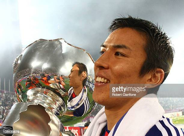 Japan captain Makato Hasebe holds the winners trophy after Japan defeated Australia in extra time 1-0 at the AFC Asian Cup Final match between the...