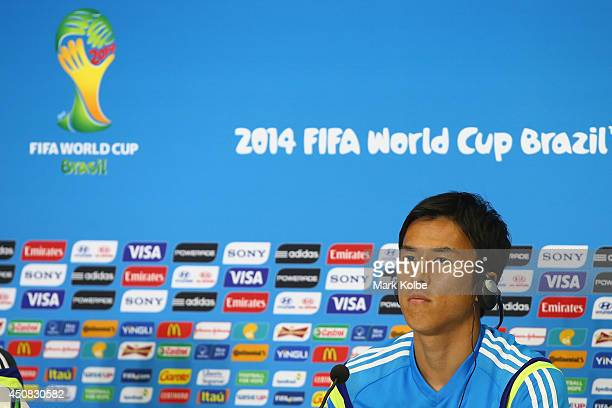 Japan Captain Makoto Hasebe looks on as he listens to questions from the media during a Japan press conference session at the Dunas Arena in Natal on...