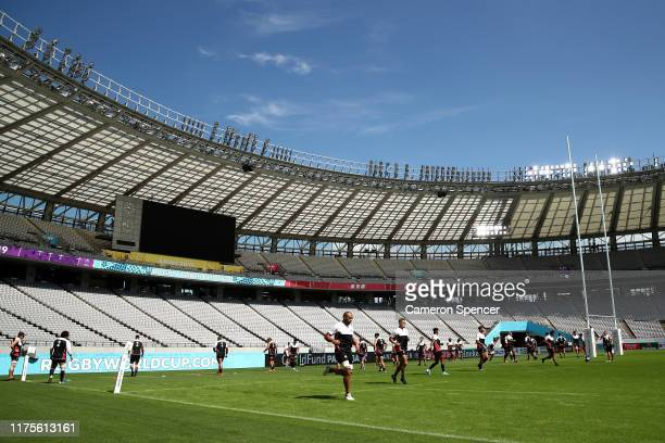 Japan captain Michael Leitch and team mates warm up during the Japan Captain's Run at the Tokyo Stadium on September 19 2019 in Chofu Tokyo Japan