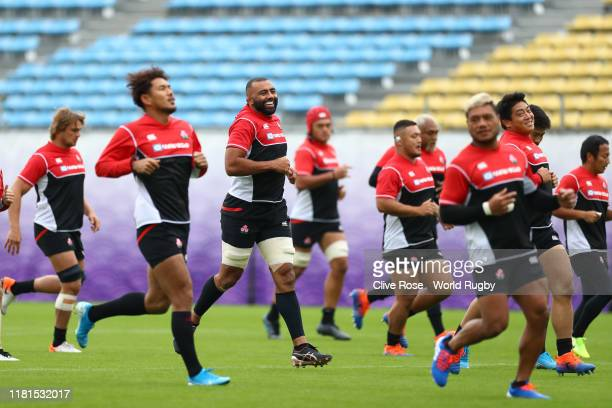 Japan captain Michael Leitch smiles with team mates during a 2019 Rugby World Cup Japan team training session at Chichibunomiya Rugby Stadium on...