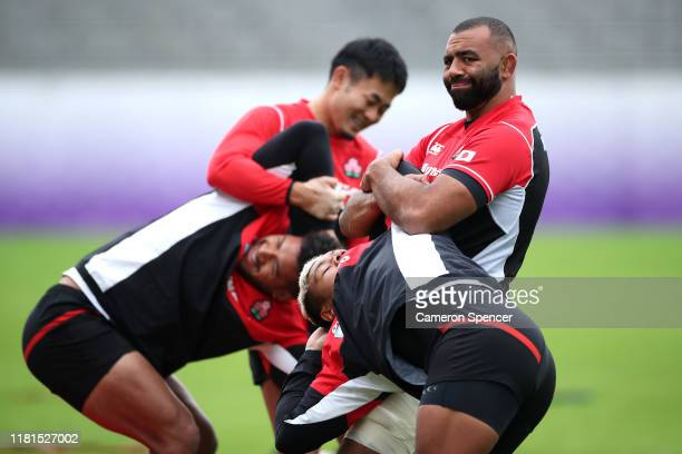 Japan captain Michael Leitch stretches team mate Lomano Lava Lemeki during a 2019 Rugby World Cup Japan team training session at Chichibunomiya Rugby...