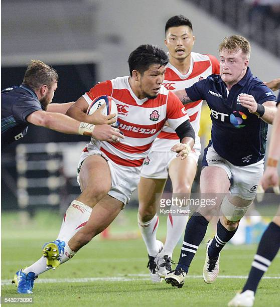 Japan captain Shota Horie runs with the ball in a 21-16 loss to Scotland in the last of their two-test series at Ajinomoto Stadium in Tokyo on June...