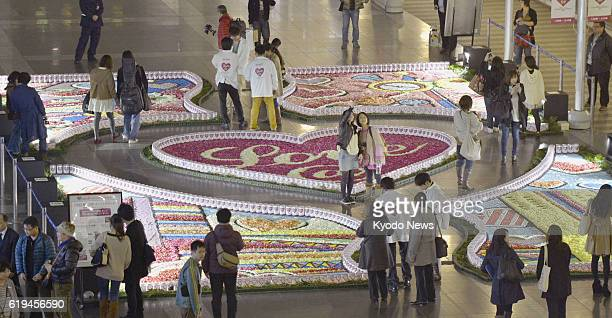 OSAKA Japan ''Carpets'' made of petals are on display at Osaka Station in Osaka on March 9 2013