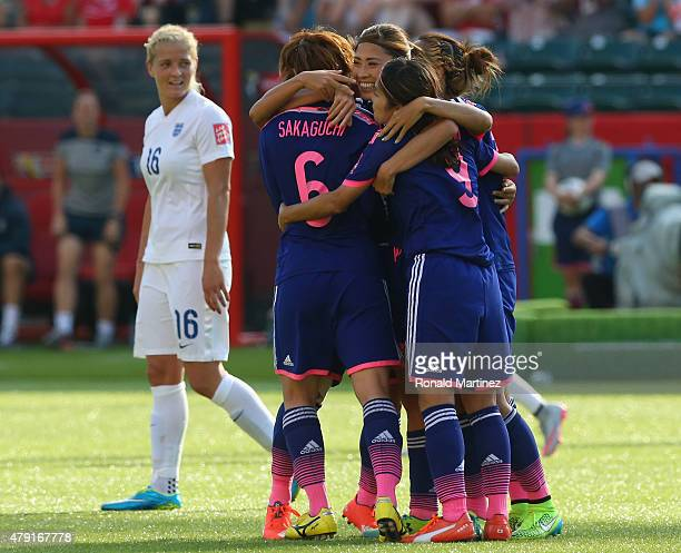 Japan celebrate a last minute winning goal during the FIFA Women's World Cup Semi Final match between Japan and England at the Commonwealth Stadium...