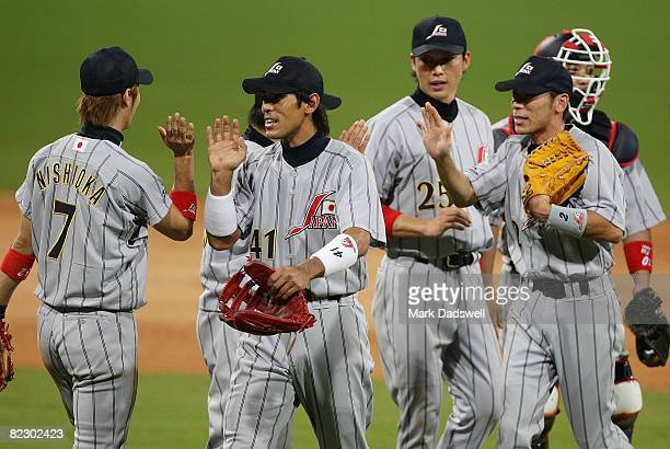 Japan celebrate after defeating the Chinese Taipei 61 during their preliminary baseball game at the Wukesong Baseball Field during Day 6 of the...