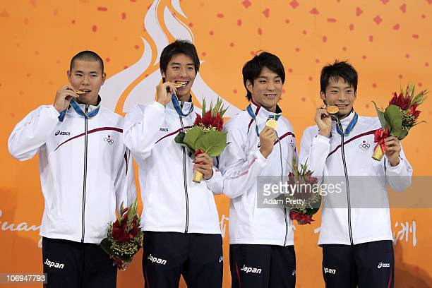 Japan celebrate after receiving the gold medals won in the Men's 4x100m Medley Relay final during day six of the 16th Asian Games Guangzhou 2010 at...