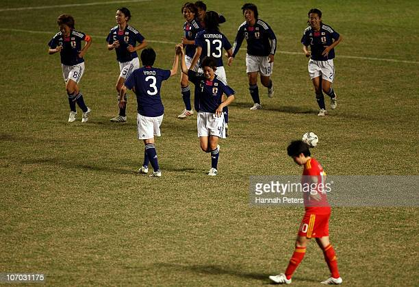 Japan celebrate after Shinobu Ohno of Japan scores the first goal in extra time during the Women's Semi final match between Japan and China at Yuexiu...