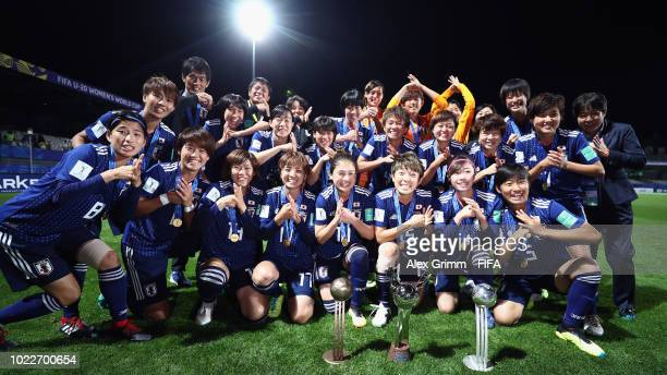 Japan celebrate after the FIFA U20 Women's World Cup France 2018 Final match between Spain and Japan at Stade de la Rabine on August 24 2018 in...