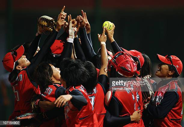 Japan celebrate after winning the final match between China and Japan at Tianhe Softball Field during day fourteen of the 16th Asian Games Guangzhou...