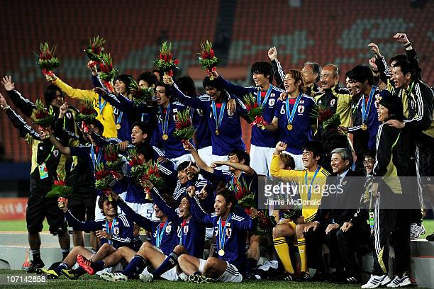 Japan celebrate after winning the gold in the Men's Final between United Arab Emirates and Japan at Tianhe Stadium during day thirteen of the 16th...