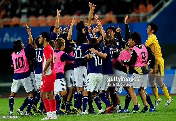 Japan celebrate at the final whistle after winning gold in the Men's Final between United Arab Emirates and Japan at Tianhe Stadium during day...