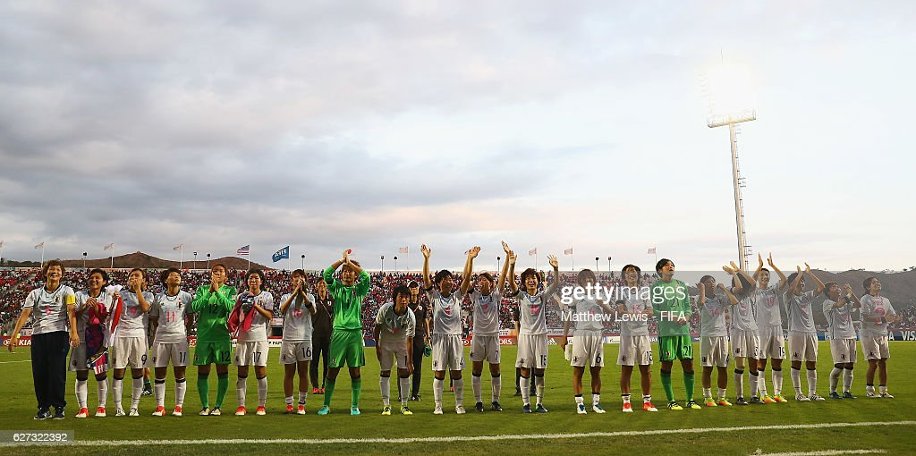 Japan celebrate third place, after beating USA during the FIFA U-20 Women's World Cup Papua New Guinea 2016 Third Place Play Off match between USA and Japan at the National Football Stadium on December 3, 2016 in Port Moresby, Papua New Guinea.