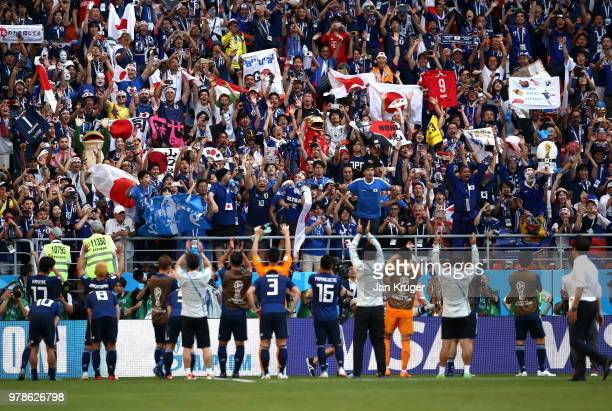 Japan celebrate with fans after winning the 2018 FIFA World Cup Russia group H match between Colombia and Japan at Mordovia Arena on June 19 2018 in...