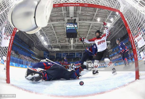 Japan celebrates a goal scored by Shoko Ono of Japan in the first period against Korea during the Women's Ice Hockey Preliminary Round Group B game...