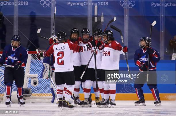 Japan celebrates after scoring a goal in the first period against Korea during the Women's Ice Hockey Preliminary Round Group B game between Korea...