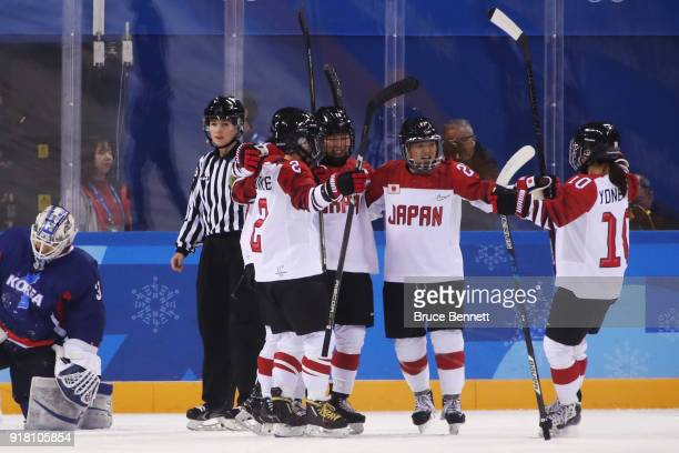 Japan celebrates as Shoko Ono of Japan scores a goal in the first period against Korea during the Women's Ice Hockey Preliminary Round Group B game...