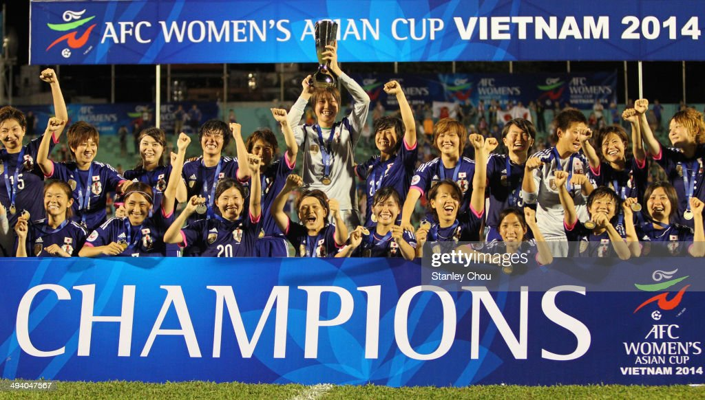 Japan celebrates with the Asian Cup Trophy after defeatoing Australia 1-0 during the AFC Women's Asian Cup Final match between Japan and Australia at Thong Nhat Stadium on May 25, 2014 in Ho Chi Minh City, Vietnam.