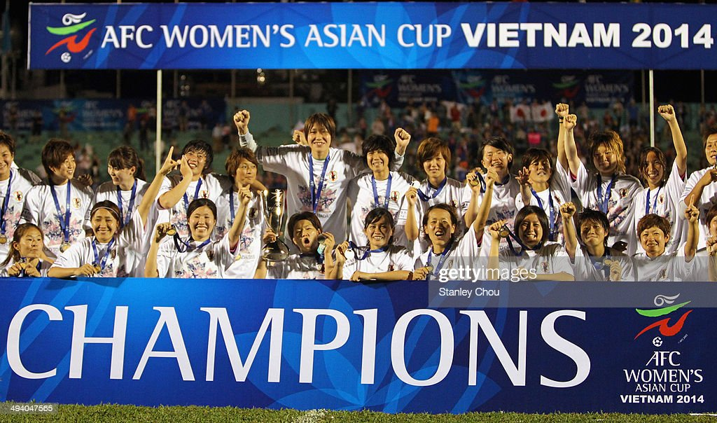 Japan celebrates with the Asian Cup Trophy defeating Australia 1-0 during the AFC Women's Asian Cup Final match between Japan and Australia at Thong Nhat Stadium on May 25, 2014 in Ho Chi Minh City, Vietnam.