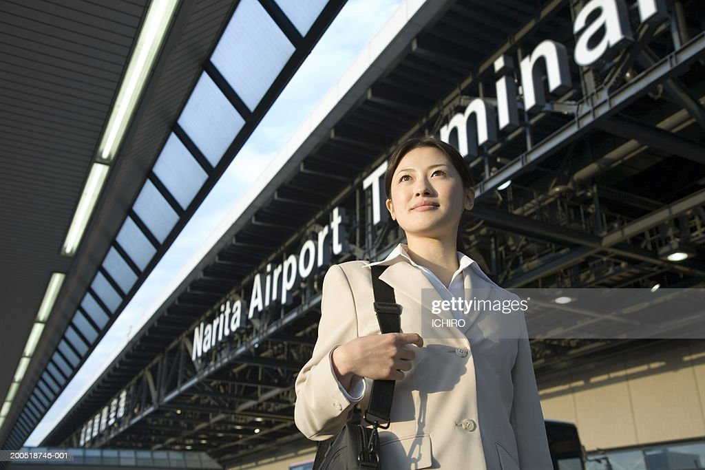 Japan, Chiba Prefecture, young businesswoman at Narita Airport : Stock Photo