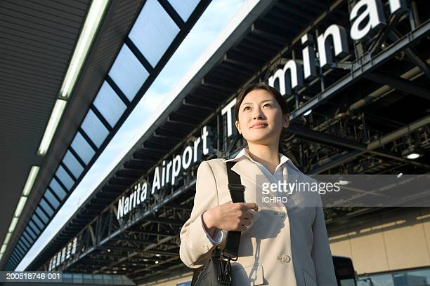 japan, chiba prefecture, young businesswoman at narita airport - narita international airport stock photos and pictures