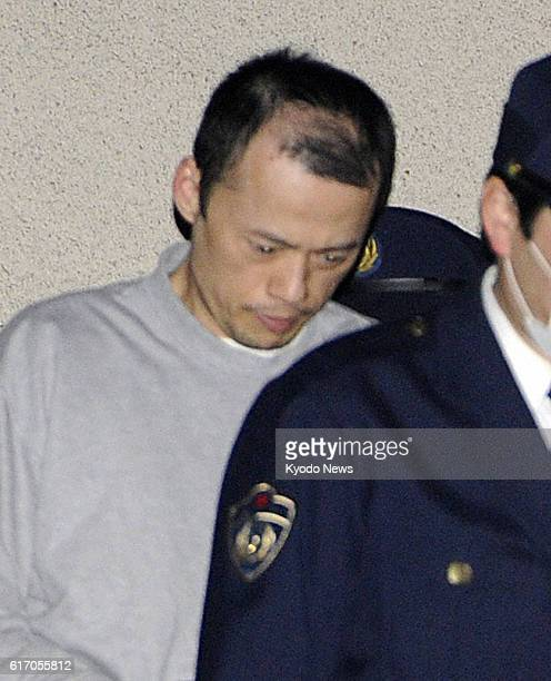 HIROSHIMA Japan Chinese convict Li Guolin is escorted by police officers at a police station in Hiroshima on Jan 13 after being recaptured two days...