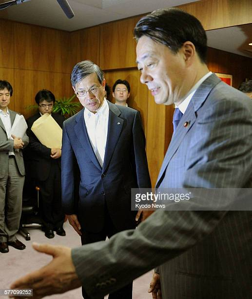 TOKYO Japan Chubu Electric Power Co President Akihisa Mizuno arrives for a meeting with Economy Trade and Industry Minister Banri Kaieda at the...