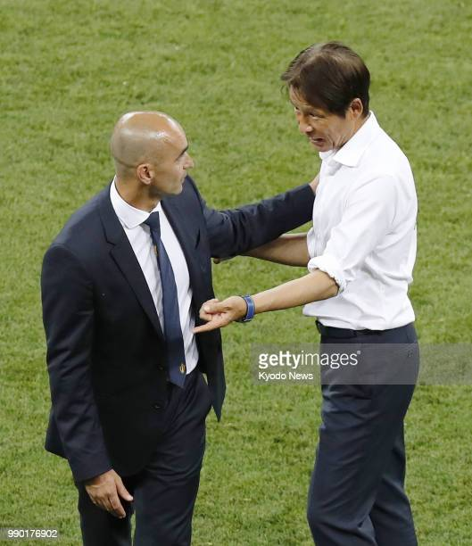 Japan coach Akira Nishino and Belgium coach Roberto Martinez complement each other after a World Cup roundof16 match between the two countries in...